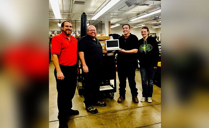From left: Automotive instructor Andy Hooton, Matco Tools dealer Tim Wininger, Auto Club President Kenneth Souder (grade 12), Destiny Peterson (grade 10). (Photo Courtesy of MUHS)