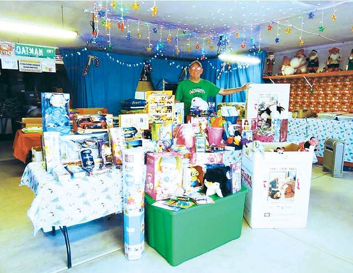Butch Meriwether proudly stands with the 116 toys and $343 dollars donated by caring visitors to his and Chris Marie's Golden Valley Christmas display during the 2016 Christmas Season. The toys and cash were dropped off during December to the Marine Corps League detachment #887 to purchase additional toys that were given out to needy children in northern Mohave County for Christmas. For more information about Toys for Tots and the Marine Corps League, contact Detachment Commandant Terry Flanagan by email at commandant@MCL887.org, or call 928-718-TOYS (8697).