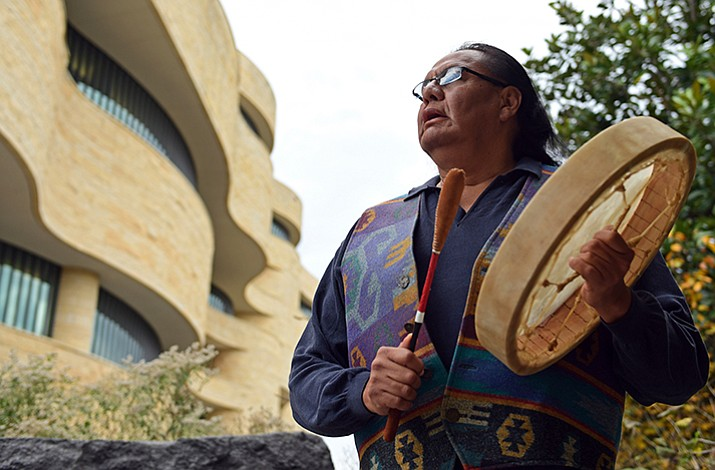 Dennis Zotigh poses for a photo outside the National Museum of the American Indian in Washington, Friday. (Susan Walsh/AP)