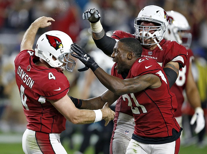 Arizona Cardinals kicker Phil Dawson (4) celebrates his game winning 57-yard field goal during the second half of an NFL football game against the Jacksonville Jaguars with cornerback Patrick Peterson (21), Sunday, Nov. 26, 2017, in Glendale. The Cardinals won 27-24. (Ross D. Franklin/AP)