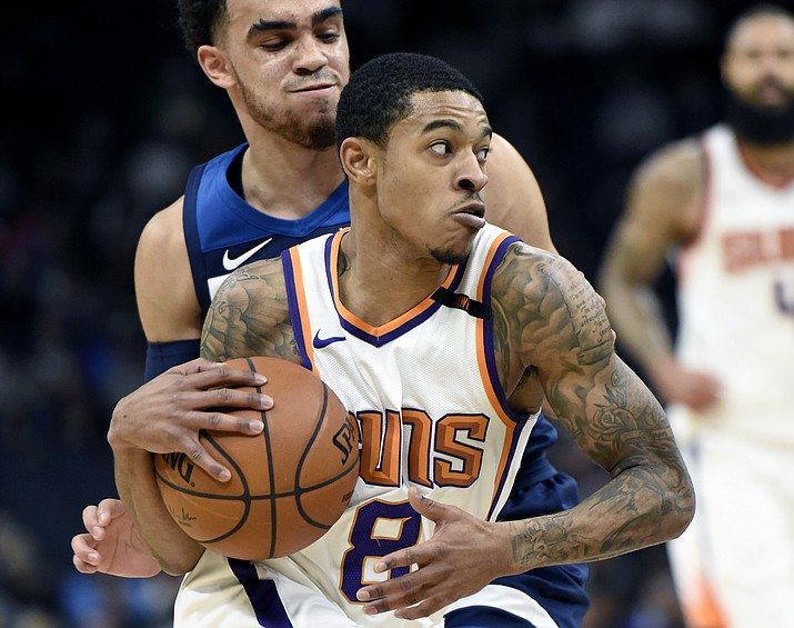 Phoenix Suns guard Tyler Ulis (8) drives to the basket against Minnesota Timberwolves guard Tyus Jones (1) during the first quarter of an NBA basketball game on Sunday, Nov. 26, in Minneapolis. (Hannah Foslien/AP)