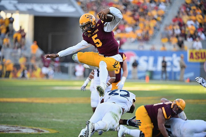 ASU captured the Territorial Cup over Arizona with a three-touchdown performance from Sun Devils' quarterback Manny Wilkins. (Sun Devils Athletics photo)