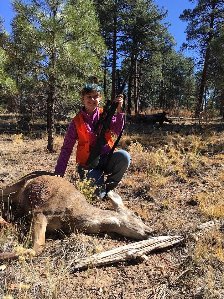 Kingman resident Deborah Smith, 13, shows the mule deer doe that she bagged on her first ever big game hunt in Arizona! Thing young hunter used a 3-way rifle to take the deer with one shot at 200 yards. (Photo special to the Miner)