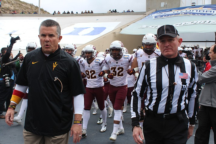 Arizona State University head football coach Todd Graham leads his team to the field prior to the 2014 Sun Bowl at the Sun Bowl Stadium in El Paso, Tex. on Dec. 27, 2014.