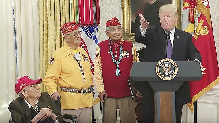 President Donald Trump speaks at an Oval Office event honoring Native American Code Talkers. From left, Fleming Begaye, Thomas Begay and Peter MacDonald. (Photo courtesy the White House)