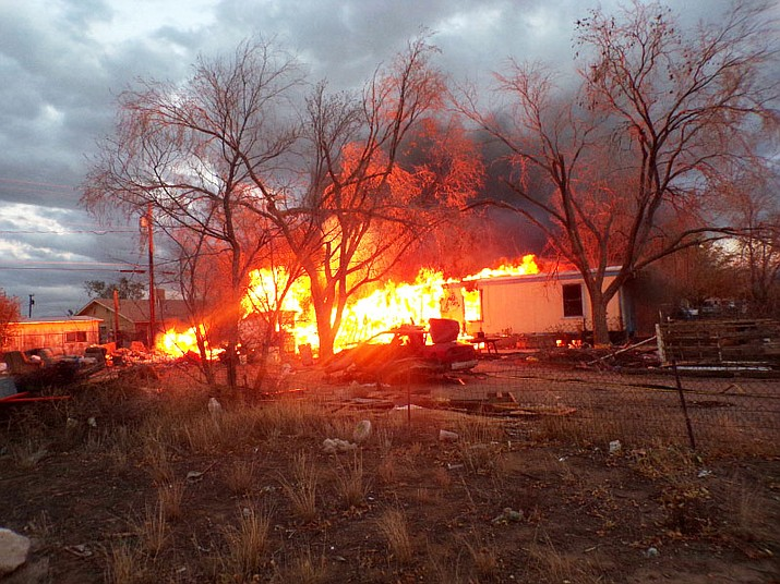 Fire engulfs a mobile home in the Birdland area Monday evening. The home and a nearby travel trailer were destroyed.