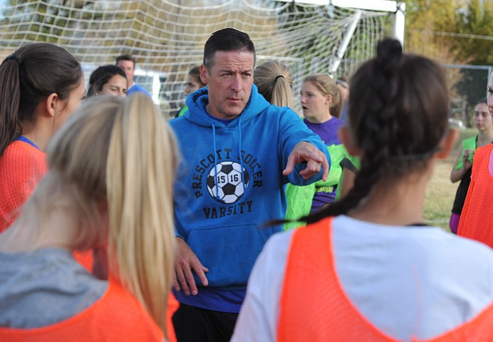 Prescott girls' soccer head coach Paul Campuzano talks to players during practice after school Tuesday, Nov. 21, 2017, in Prescott. (Les Stukenberg/Courier)