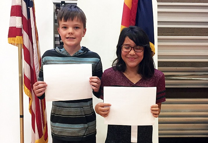 Seventh grade student Kent Stafford (left) and fifth grade student Stori Betts display their certificates