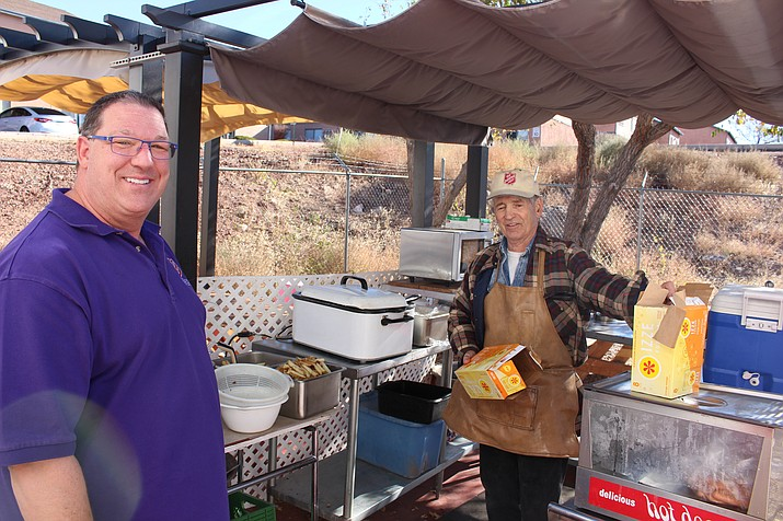 Troy Palmer, left, director of Salvation Army in Kingman, appreciates volunteers like Steve Shaffer, who cooks lunch three days a week for the homeless. Shaffer has also worked as a bell ringer for the Red Kettle drive during his 10 years of volunteering for the Salvation Army.