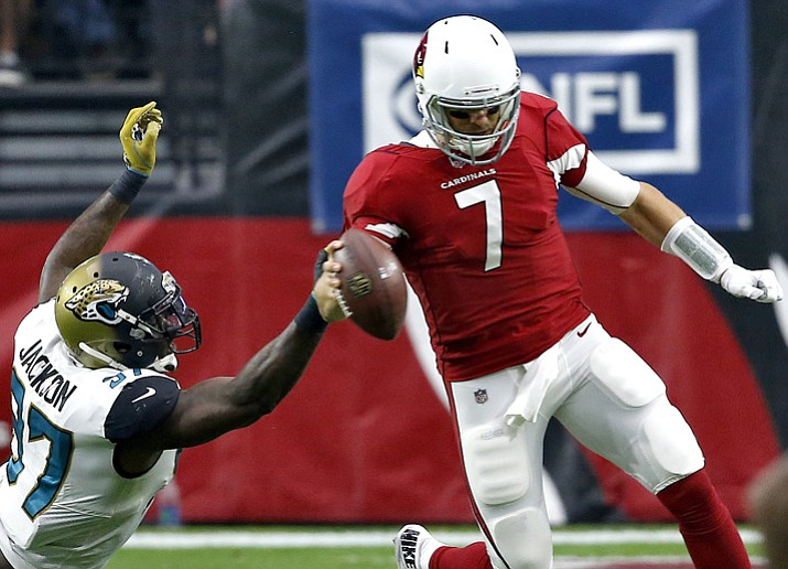 Arizona Cardinals quarterback Blaine Gabbert (7) is dragged down by Jacksonville Jaguars defensive tackle Malik Jackson (97) during the first half Sunday, Nov. 26, 2017, in Glendale. (Ross D. Franklin/AP)