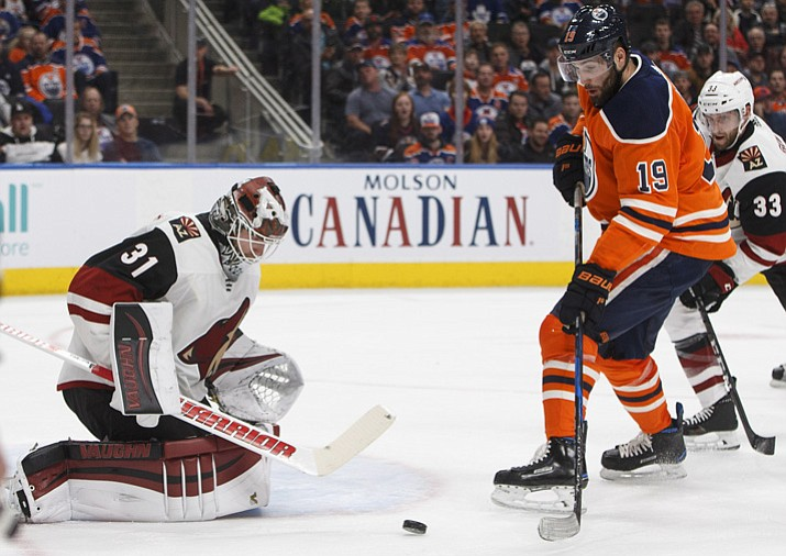 Phoenix Coyotes goalie Scott Wedgewood (31) stops Edmonton Oilers' Patrick Maroon (19) during the second period of an NHL hockey game in Edmonton, Alberta, Tuesday, Nov. 28, 2017. (Jason Franson/The Canadian Press via AP)