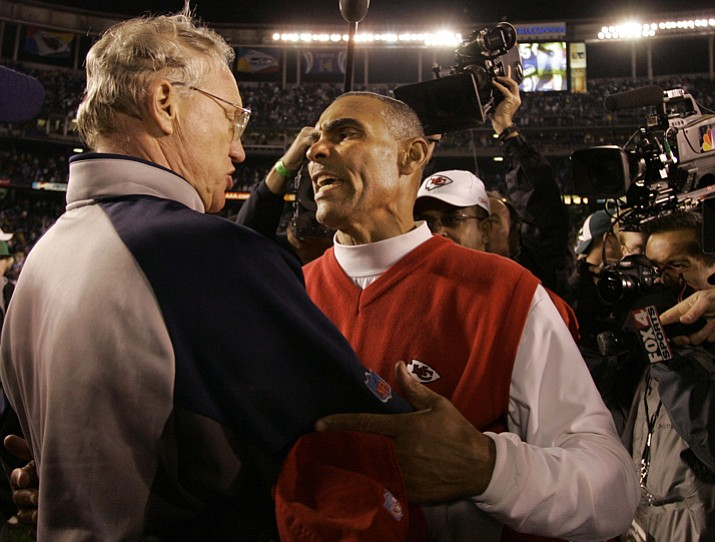 Former Kansas City Chiefs' coach Herman Edwards, right, and former San Diego Chargers' coach Marty Schottenheimer, talk after the Chargers' 20-9 victory Dec. 17, 2006. Sources indicate Edwards is scheduled to interview for the Arizona State football job. (Chris Park/AP, File)