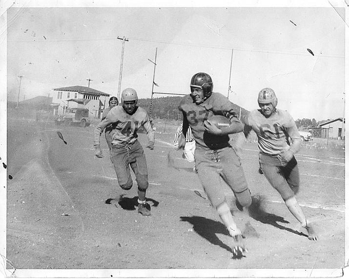 Vikings football players play a game in the early 1950s in Williams.