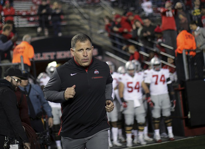 This Sept. 30, 2017, file photo shows former Rutgers football head coach, now Ohio State associate head coach/defensive coordinator, Greg Schiano running onto the field before an NCAA college football game against Rutgers in Piscataway, N.J. (Mel Evans/AP, File)