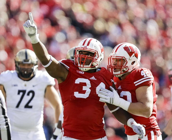 This Oct. 17, 2015, file photo shows Wisconsin's Chikwe Obasih (34) celebrating after a sack in Madison, Wis. (Andy Manis/AP, File)