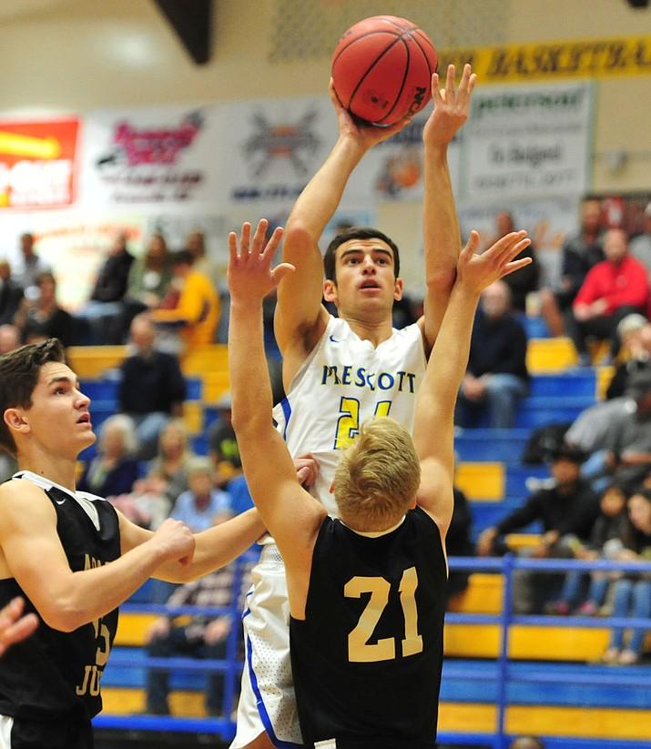 Prescott's Charles Hicks (24) goes up for a shot as the Badgers take on Apache Junction in boys basketball Wednesday night in Prescott. (Les Stukenberg/Courier)