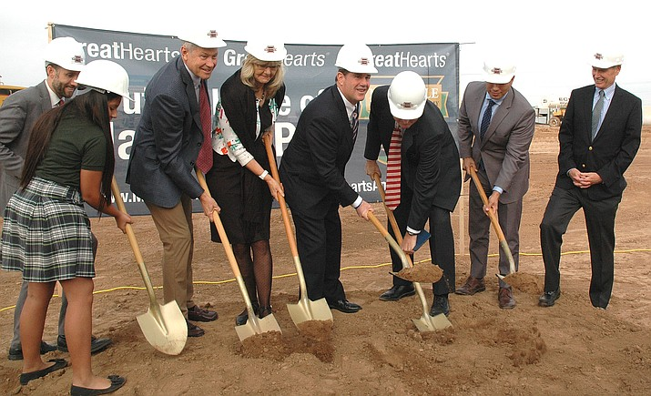 Gov. Doug Ducey, center, helps break ground Wednesday for a new branch of GreatHearts Academy, a nonprofit charter school network. The campus is being financed with public help state because of legislation pushed by the governor to have the state guarantee payment on its borrowing. (Capitol Media Services photo by Howard Fischer)