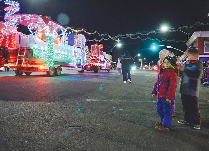 Many children like those on the right enjoyed the Very Merry Parade of Lights in downtown Kingman.