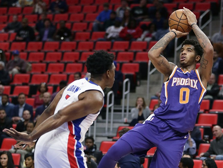 Phoenix Suns forward Marquese Chriss (0) takes a shot against Detroit Pistons forward Stanley Johnson (7) during the first half of an NBA basketball game Wednesday, Nov. 29, 2017 in Detroit. (Duane Burleson/AP)