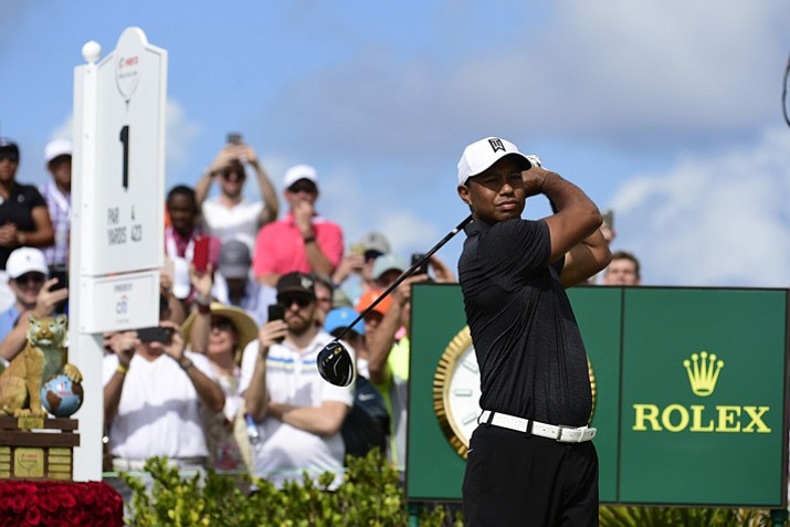 Tiger Woods tees off on the first hole at the Hero World Challenge golf tournament at Albany Golf Club on Thursday, Nov. 30, 2017, in Nassau, Bahamas. (Dante Carrer/AP)