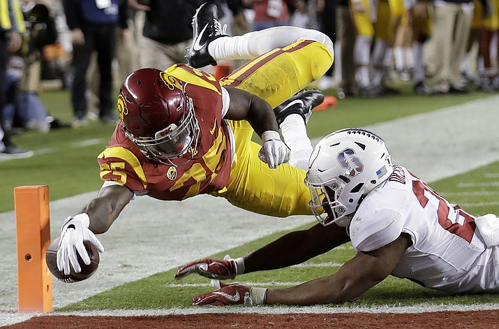 USC running back Ronald Jones II, top, dives near Stanford linebacker Bobby Okereke during the first half of the Pac-12 Conference championship football game in Santa Clara, Friday, Dec. 1. (Marcio Jose Sanchez/AP)