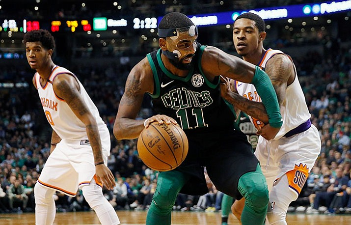 Boston's Kyrie Irving (11) looks to move against the Suns' Tyler Ulis right, during the third quarter of an NBA basketball game in Boston, Saturday, Dec. 2. The Celtics won 116-111. (Michael Dwyer/AP)