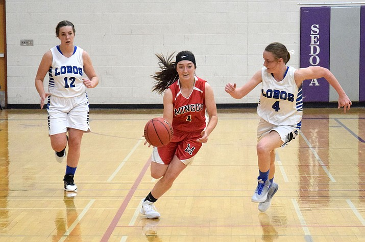 Mingus senior Kaycee Williams dribbles past a Lobo during the Marauders' 39-24 loss to Snowflake on Friday in the Red Rock Hoops Classic at Sedona Red Rock. (VVN/James Kelley)