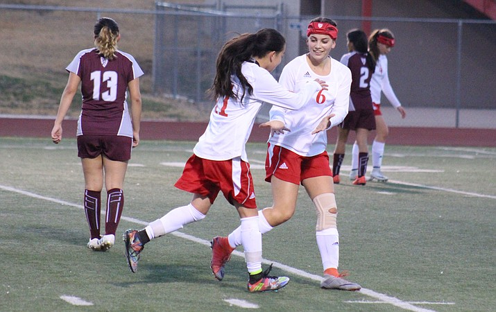 Mingus sophomores Marli Urueta (11) and Felicia Bueno (6) celebrate a Urueta goal during the Marauders' 7-0 win over Metro Tech on Friday. Urueta scored nine goals int he first four games of the season and Bueno seven, (VVN/James Kelley)