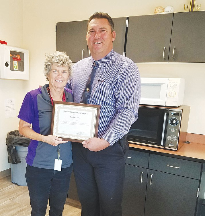 Mohave County Sheriff's Office Public Information Officer Trish Carter retired Friday after 14 years of service. Sheriff Doug Schuster showed his appreciation.