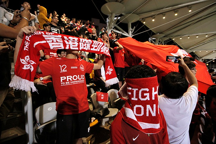 Hong Kong soccer fans cover their faces and boo the Chinese national anthem before the friendly match against Bahrain football team in Hong Kong, Thursday, Nov. 9, 2017. Hong Kong soccer fans again booed China's national anthem at the Thursday night match in the Chinese-controlled city, defying Beijing authorities days after communist leaders moved to tighten up penalties for disrespecting the song. (Kin Cheung/AP)