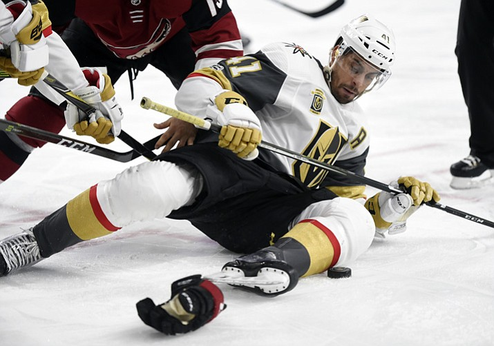 Vegas Golden Knights right wing Pierre-Edouard Bellemare reaches for the puck after a face off against the Arizona Coyotes of an NHL hockey game, Sunday, Dec. 3, 2017, in Las Vegas. Vegas won 3-2 in overtime. (David Becker/AP)