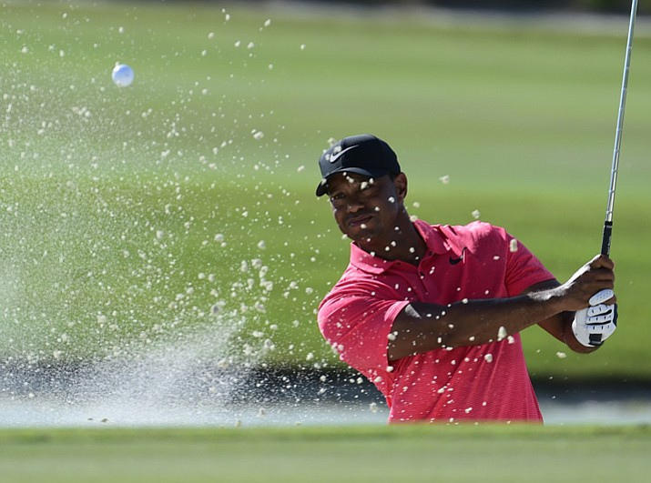 Tiger Woods hits from a bunker on the 17th hole during the final round of the Hero World Challenge golf tournament at Albany Golf Club in Nassau, Bahamas, Sunday, Dec. 3, 2017. (Dante Carrer/AP)