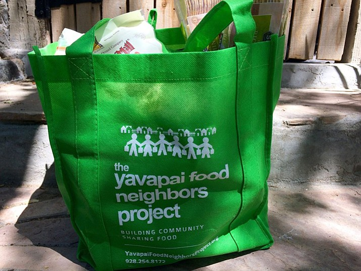 The Yavapai Food Neighbors Program asks residents to fill a green bag with non-perishable food items and leave it to be picked up. The food goes to local food banks and the driver will leave another green bag. (Yavapai Regional Medical Center)