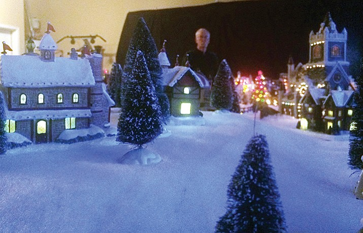Art Cederholm showcases a Christmas village he sets up in his garage. (Jason Wheeler/Review)