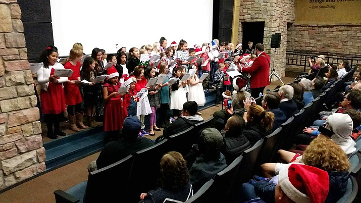 Grand Canyon elementary students performed their own unique sing-along at the annual holiday open house at the Grand Canyon Visitor Center Nov. 30.
