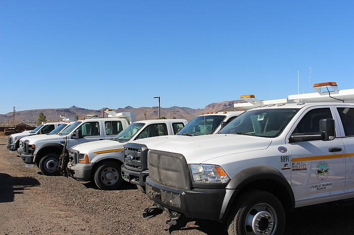 A fleet of Mohave County Public Works trucks are parked at the yard on Sunshine Drive. Mechanics, technicians and shop supervisors, along with office specialists, were approved for a 15.8 percent pay raise by the Board of Supervisors Monday.
