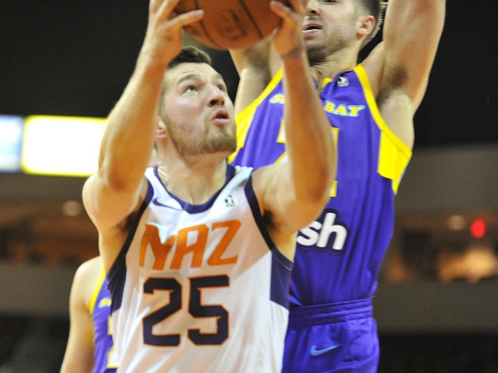 Northern Arizona's Alec Peters goes up for a basket as the Suns face the South Bay Lakers on Tuesday, Dec. 5, 2017, in Prescott Valley. (Les Stukenberg/Courier)