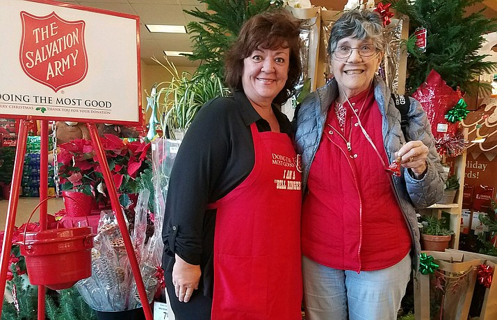 Kerry-Lynn Moede and Dee Neilson ring the bell for the Salvation Army at Safeway Dec. 1.