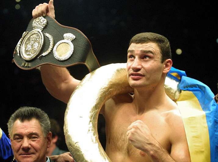 In this Jan. 28, 2001, file photo, Vitali Klitschko, of Ukraine, shows the world championship belt. after he knocked out Orlin Norris of the United States in the first round of a WBO heavyweight title fight in Munich, Germany. (Camay Sungu/AP, File)