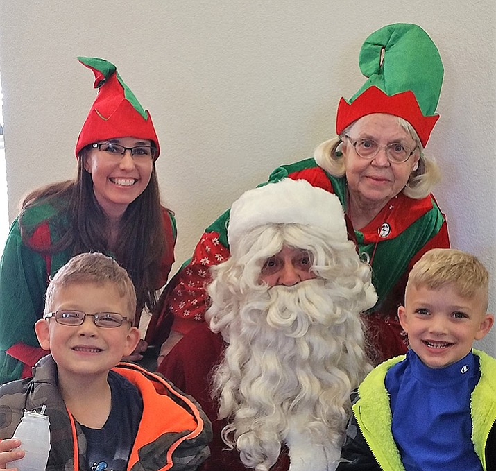 Boston and Lawson Soza with Santa and his Elf Helpers at the Chino Valley Elks Lodge's Clothe-a-Child event. (Dawn Montelius/courtesy)