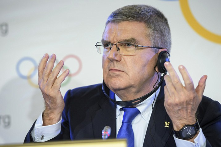 International Olympic Committee, IOC, President Thomas Bach from Germany, reacts during a media conference after an Executive Board meeting Tuesday, Dec. 5, 2017, in Lausanne, Switzerland. (Jean-Christophe Bott/Keystone via AP)
