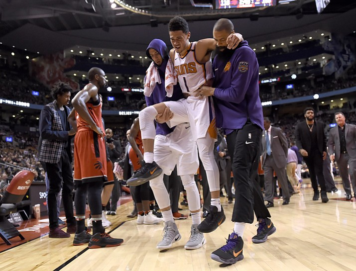 PHOTO: Phoenix Suns guard Devin Booker (1) is carried off by teammates during the second half Tuesday, Dec. 5, 2017, in Toronto. (Nathan Denette/The Canadian Press via AP)