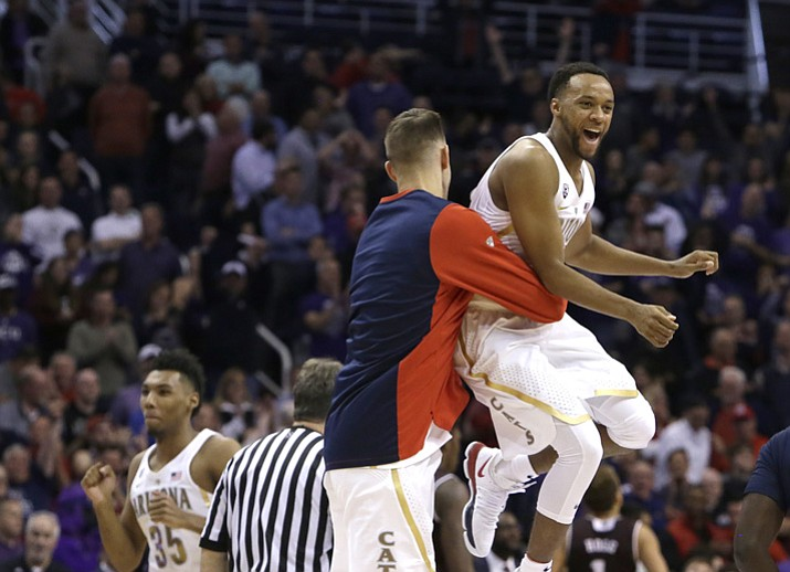 Arizona guard Parker Jackson-Cartwright, right, celebrates with a teammate after defeating Texas A&M 67-64 on Tuesday, Dec 5, 2017, in Phoenix. (Rick Scuteri/AP)