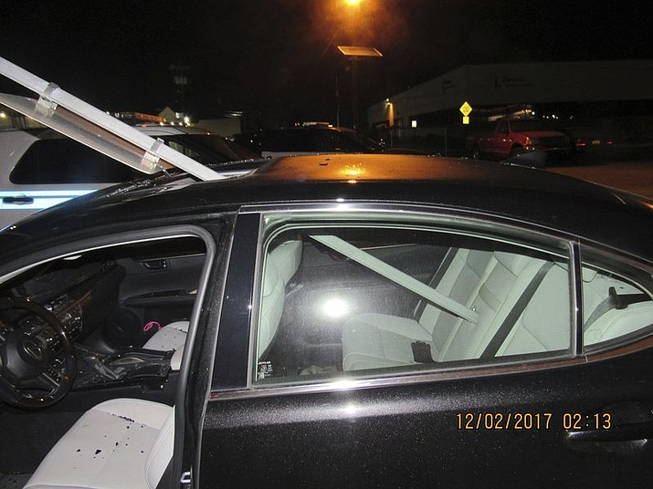New Jersey police say a woman was drunk when she continued driving with a mass transit sign sticking out of the roof of her car. The 52-year-old was pulled over Saturday, Dec. 2, 2017, on Route 46 in South Hackensack and has been charged with driving while intoxicated and careless driving. (South Hackensack Police Department via AP)