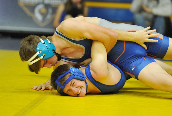 Chino Valley's J.C. Mortenson wrestles Mayer's Wyatt Frye during the Yavapai County Duals on Nov. 25 in Prescott. The Cougars lost to Flagstaff, Snowflake and Coconino on Wednesday, Dec. 6, in a four-way multiple in Flagstaff. (Les Stukenberg/Courier, File)