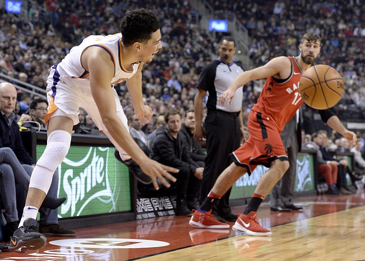 Phoenix Suns guard Devin Booker passes the ball against Toronto on Tuesday, Dec. 5, 2017, in Toronto. (Nathan Denette/The Canadian Press via AP)