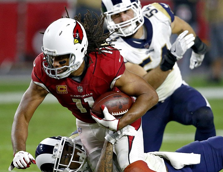 PHOTO: Arizona Cardinals wide receiver Larry Fitzgerald (11) is hit against the Los Angeles Rams during the second half Sunday, Dec. 3, 2017, in Glendale. The Rams won 32-16. (Ross D. Franklin/AP, File)