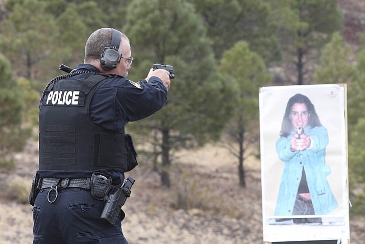 A Williams Police officer demonstrates using a gun mounted camera at the Williams Police range Nov. 30. The Williams Police Department is one of 12 organizations testing the cameras. (Loretta Yerian/WGCN)