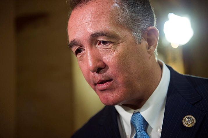 Rep. Trent Franks, R-Ariz. speaks with a reporter in Washington in a file photo. Franks says he is resigning Jan. 31 amid a House Ethics Committee investigation of possible sexual harassment. Franks says in a statement that he never physically intimidated, coerced or attempted to have any sexual contact with any member of his staff. (Cliff Owen, AP file)