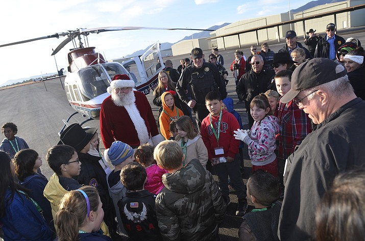 Santa arrives at the Cottonwood airport via helicopter after a long flight from the North Pole during last year's Shop with a Cop event. (VVN/Vyto Starinskas)